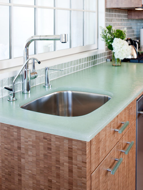 green kitchen worktop 75 kitchen with green splashback and glass worktops design 1455