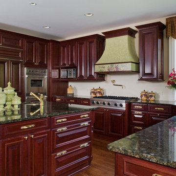 WoodMode Cherry Cabinet Kitchen with Brass Hardware and Stucco Hood