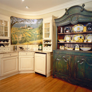 Example of a huge farmhouse u-shaped medium tone wood floor enclosed kitchen design in Chicago with granite countertops, an undermount sink, raised-panel cabinets, white cabinets, paneled appliances and an island