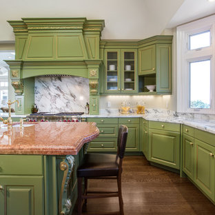 Inspiration for an expansive classic u-shaped kitchen in San Francisco with raised-panel cabinets, green cabinets, granite worktops, white splashback, stone slab splashback, stainless steel appliances and dark hardwood flooring.
