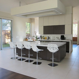 Kitchen - modern kitchen idea in San Francisco with flat-panel cabinets and beige cabinets