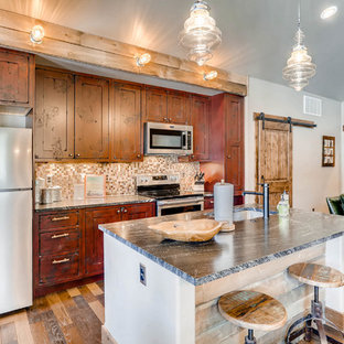 Inspiration for a small country open plan kitchen in Denver with an undermount sink, shaker cabinets, red cabinets, granite benchtops, brown splashback, glass tile splashback, stainless steel appliances, dark hardwood floors, with island and brown floor.