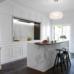 Inspiration for a small transitional galley separate kitchen in Sydney with an undermount sink, raised-panel cabinets, white cabinets, marble benchtops, dark hardwood floors, with island and white benchtop.