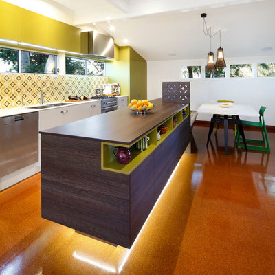 Eat-in kitchen - contemporary galley orange floor eat-in kitchen idea in Sydney with flat-panel cabinets, wood countertops, green backsplash and white cabinets