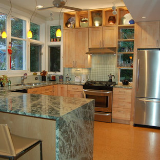 This is an example of a medium sized contemporary u-shaped kitchen/diner in DC Metro with a submerged sink, shaker cabinets, light wood cabinets, granite worktops, green splashback, glass tiled splashback, stainless steel appliances, cork flooring, a breakfast bar, brown floors and green worktops.