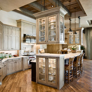 Design ideas for a country eat-in kitchen in Other with glass-front cabinets, beige cabinets, beige splashback and stainless steel appliances.