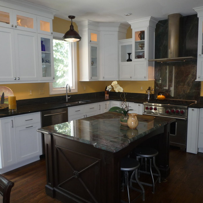 Yellow Kitchen with Green Fire Granite and White Cabinets