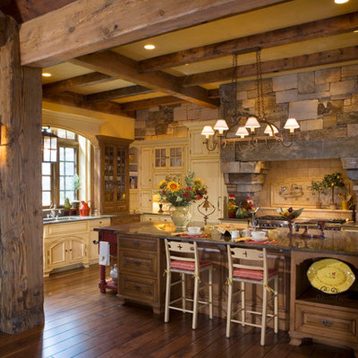 Kitchen - rustic kitchen idea in Other with raised-panel cabinets, medium tone wood cabinets, beige backsplash and stainless steel appliances