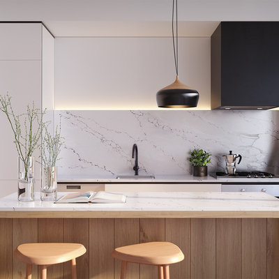Trendy galley open concept kitchen photo in Melbourne with a drop-in sink, flat-panel cabinets, white cabinets, white backsplash, marble backsplash, black appliances and an island