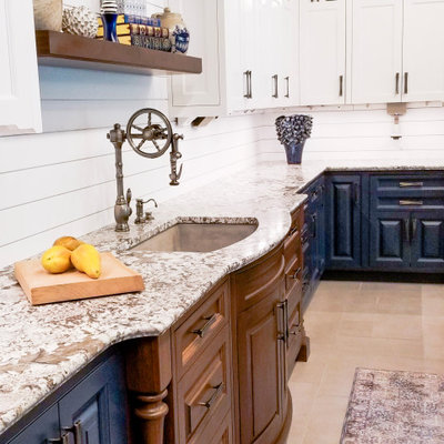 Example of a transitional beige floor kitchen design in Portland Maine with an undermount sink, raised-panel cabinets, blue cabinets and gray countertops