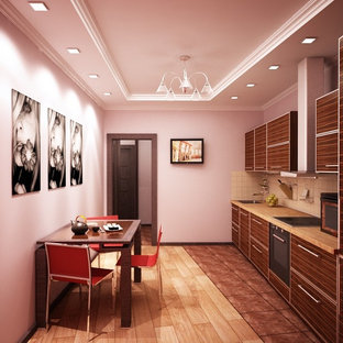 Inspiration for a small single-wall kitchen/diner in Other with a single-bowl sink, flat-panel cabinets, medium wood cabinets, wood worktops, beige splashback, cement tile splashback, black appliances, ceramic flooring and no island.