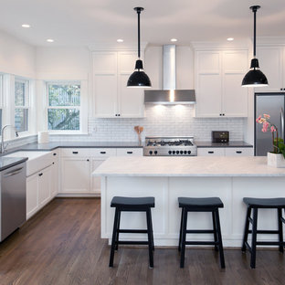 Small modern kitchen pantry designs - Small minimalist l-shaped bamboo floor kitchen pantry photo in Los Angeles with open cabinets, white backsplash, white appliances, a drop-in sink and two islands
