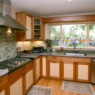 Design ideas for an eclectic kitchen in San Francisco with recessed-panel cabinets, medium wood cabinets, blue splashback, glass tile splashback and light hardwood floors.