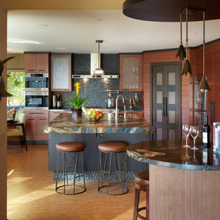 Design ideas for a mid-sized asian single-wall eat-in kitchen in San Diego with flat-panel cabinets, an undermount sink, medium wood cabinets, granite benchtops, grey splashback, mosaic tile splashback, stainless steel appliances, light hardwood floors, multiple islands and brown floor.