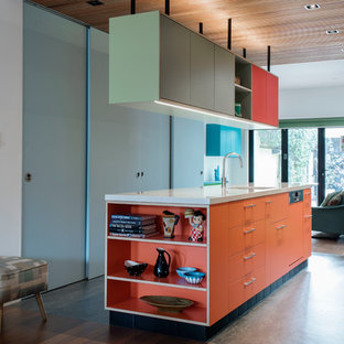 This is an example of a medium sized contemporary galley kitchen pantry in Sydney with a single-bowl sink, flat-panel cabinets, orange cabinets, terrazzo worktops, stainless steel appliances, lino flooring and an island.