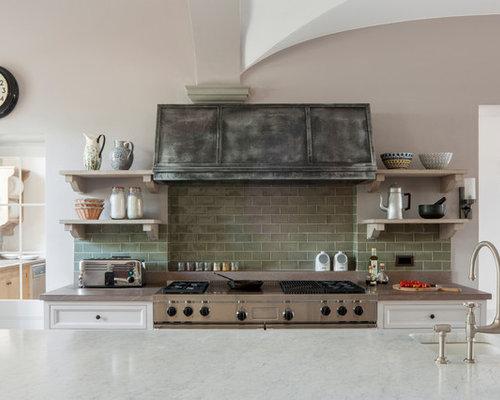Cucina industriale foto e idee per ristrutturare e arredare for Piastrelle paraspruzzi per cucina