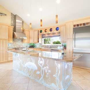 Large tropical l-shaped kitchen in Miami with light wood cabinets, granite benchtops, multi-coloured splashback, mosaic tile splashback, stainless steel appliances, porcelain floors, with island, shaker cabinets and beige floor.