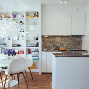 Small scandinavian kitchen remodeling - Inspiration for a small scandinavian kitchen remodel in Stockholm with flat-panel cabinets, white cabinets and a peninsula