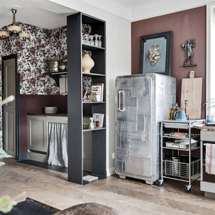 Small eclectic open concept kitchen photos - Example of a small eclectic single-wall light wood floor and beige floor open concept kitchen design in Malmo with stainless steel appliances and no island