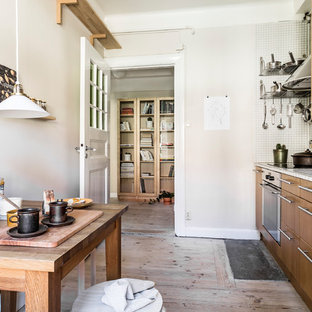 Small rustic eat-in kitchen ideas - Eat-in kitchen - small rustic single-wall light wood floor eat-in kitchen idea in Stockholm with flat-panel cabinets, medium tone wood cabinets and no island