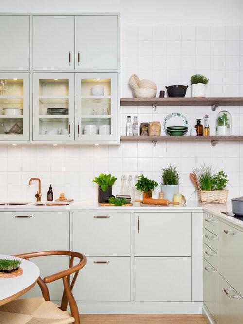 Cucina scandinava con ante verdi foto e idee per arredare - Paraspruzzi per cucina ...