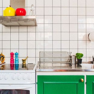 Small scandinavian kitchen designs - Small danish single-wall kitchen photo in Stockholm with a double-bowl sink, stainless steel countertops, white backsplash, porcelain backsplash and white appliances