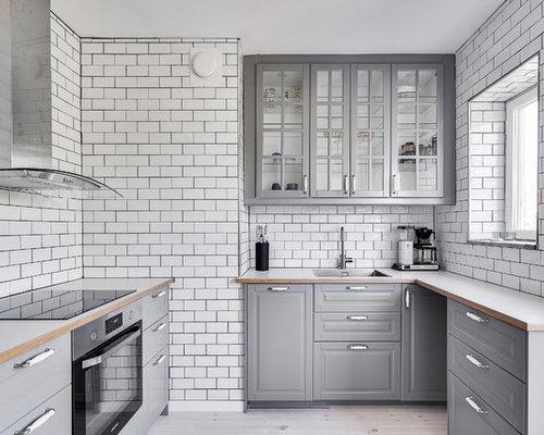 Cucina con ante di vetro e top in laminato - Foto e Idee per ...