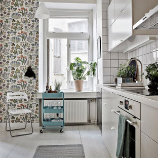 Inspiration for a small scandinavian single-wall separate kitchen in Gothenburg with flat-panel cabinets, white cabinets, solid surface benchtops, white splashback, subway tile splashback and no island.