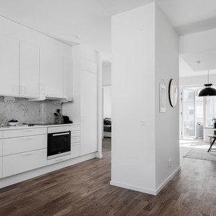 Small scandinavian open concept kitchen designs - Inspiration for a small scandinavian single-wall open concept kitchen remodel in Stockholm with white cabinets, white backsplash and marble backsplash