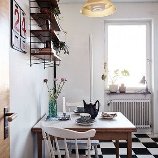 Small scandinavian eat-in kitchen ideas - Small danish single-wall ceramic floor eat-in kitchen photo in Stockholm with flat-panel cabinets, blue cabinets and no island