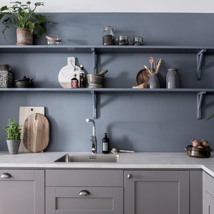 Transitional kitchen appliance - Kitchen - transitional kitchen idea in Gothenburg with a drop-in sink, shaker cabinets, gray cabinets, stainless steel appliances and white countertops