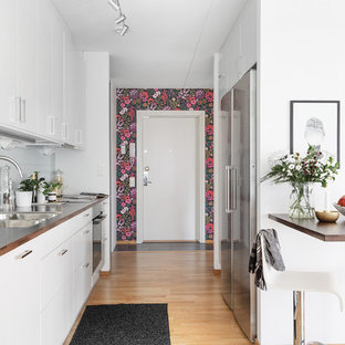 Modern single-wall kitchen in Gothenburg with flat-panel cabinets.