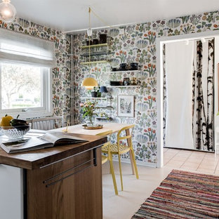 Photo of a midcentury kitchen in Gothenburg with wood benchtops, white appliances and a peninsula.