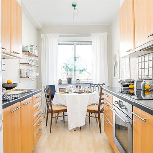 Small modern kitchen remodeling - Inspiration for a small modern kitchen remodel in Other