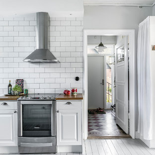 Small traditional enclosed kitchen photos - Example of a small classic enclosed kitchen design in Stockholm