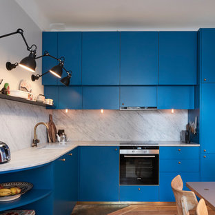 Small contemporary kitchen photos - Example of a small trendy kitchen design in Stockholm with flat-panel cabinets and blue cabinets