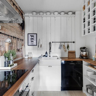 Small farmhouse kitchen inspiration - Example of a small country u-shaped light wood floor kitchen design in Stockholm with a single-bowl sink, open cabinets, white cabinets, wood countertops, white backsplash, wood backsplash, black appliances and no island