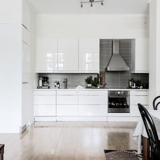Small modern open concept kitchen ideas - Open concept kitchen - small modern single-wall open concept kitchen idea in Gothenburg with white cabinets and no island