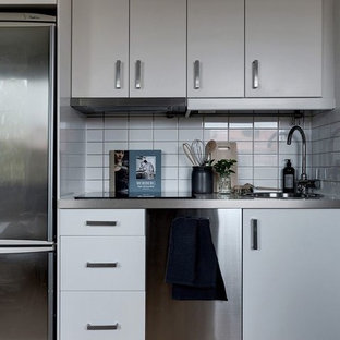 Small scandinavian kitchen remodeling - Inspiration for a small scandinavian single-wall kitchen remodel in Stockholm with flat-panel cabinets, white cabinets and no island
