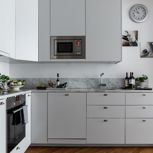 Small modern kitchen ideas - Inspiration for a small modern kitchen remodel in Stockholm with gray cabinets, marble countertops and no island