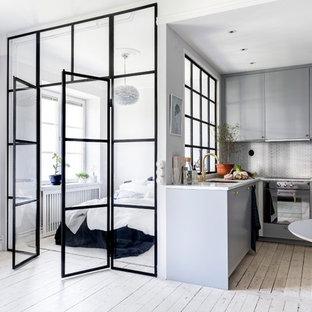 Large scandinavian kitchen ideas - Large danish light wood floor kitchen photo in Stockholm
