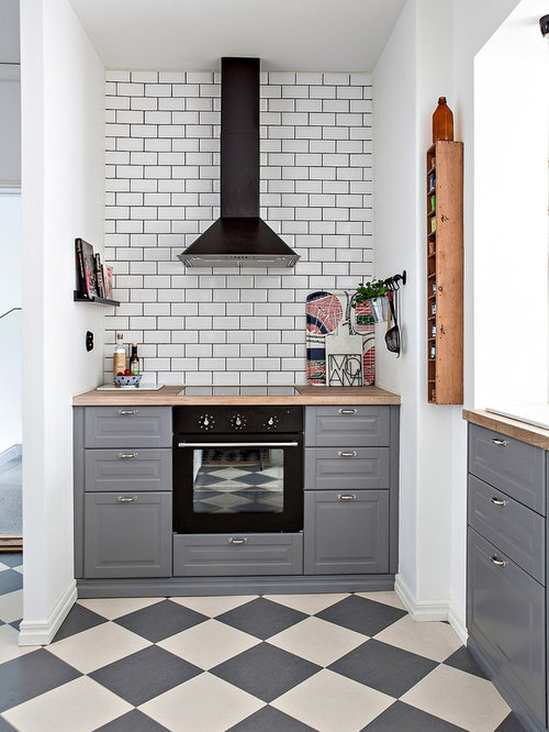 Small Scandinavian Enclosed Kitchen Photos   Example Of A Small Danish  Multicolored Floor And Linoleum Floor