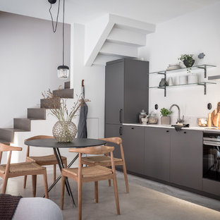 Small contemporary kitchen appliance - Kitchen - small contemporary kitchen idea in Gothenburg with flat-panel cabinets, black cabinets and no island