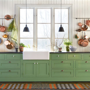 Inspiration for an expansive country single-wall kitchen in Stockholm with a farmhouse sink, shaker cabinets, green cabinets, dark hardwood floors, laminate benchtops and no island.