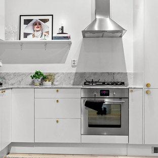 Small modern kitchen inspiration - Inspiration for a small modern kitchen remodel in Stockholm with no island