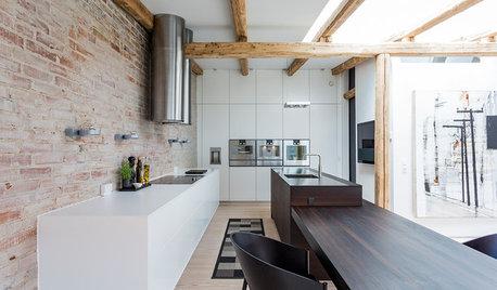 Gammel lagerbygning forvandlet til moderne byhus med drømmekøkken