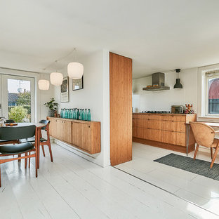 Mid-sized midcentury modern kitchen photos - Kitchen - mid-sized 1950s galley painted wood floor and white floor kitchen idea in Copenhagen with flat-panel cabinets, medium tone wood cabinets, wood countertops, white backsplash and no island