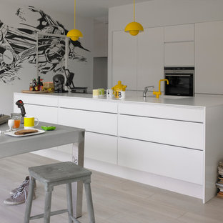 This is an example of a large modern kitchen in Other with a drop-in sink, flat-panel cabinets, white cabinets and with island.