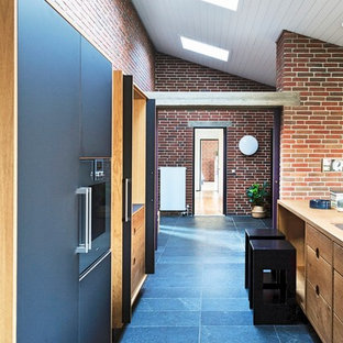 Inspiration for a large urban kitchen in Odense with laminate floors and blue floors.