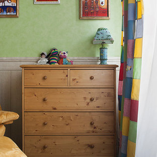 Photo of a medium sized contemporary nursery for boys in Moscow with multi-coloured walls and dark hardwood flooring.